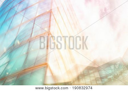 Architectural abstract. Modern building exterior with hazy coloured lighting filter and double exposure effect. Space for text.