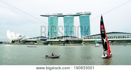SINGAPORE, 1 June 2017 - Yacht cruising by Singapore's Marina Bay Sands hotel