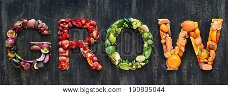 The word grow overhead flatlay word in colourful multi color fruits and vegetables veggies