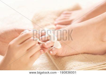 Female legs in pedicure salon