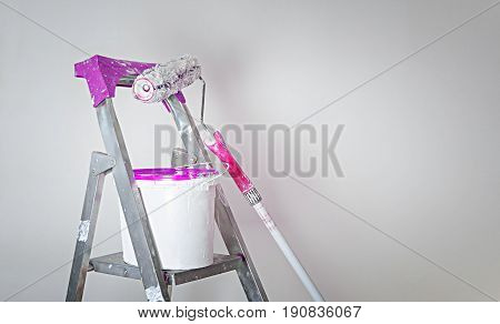Paint roller and bucket ready for use. Decoration concept.