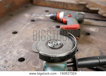 Angle grinder for metalworking in shop