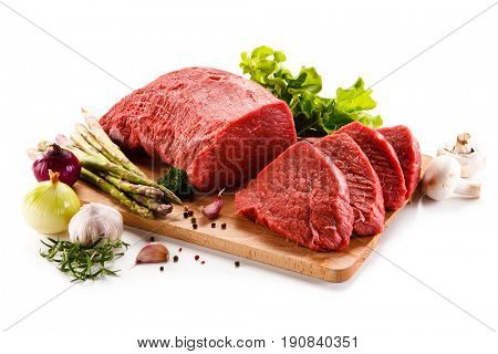 Raw beef on cutting board on white background