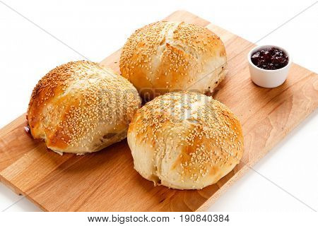 Fresh baked buns on white background