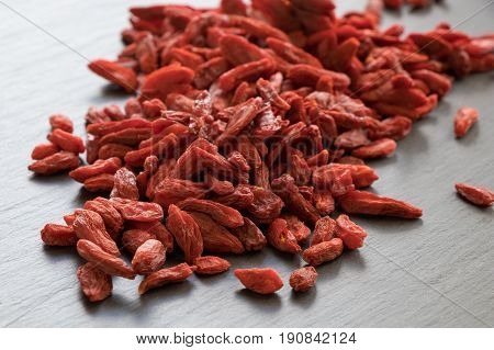 A Pile Of Dried Goji Berries On A Stone Background