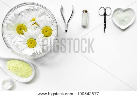 Spa composition with salt, chamomile and manicure set copyspase top view white background.