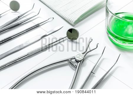 teeth care with dentist instruments in doctor's office on white background