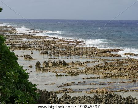 Seashore covered with coral rocks, Rota Corals and limestone cover the shoreline of this beach along the roadside heading to Rota, Northern Mariana Islands