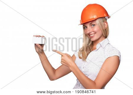 Female architect in a hard hat showing a blank business card on a white background