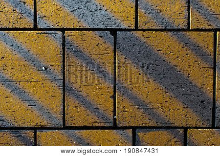 Contrasting Angular Lines On Concrete Paving Block Stones