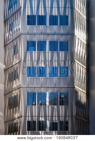 Modern Architecture Building Front Of With Vertical And Curved Lines