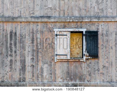 Burnt Window Shutter In Dilapidated Wooden Building