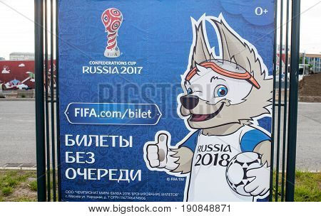 Russia Moscow June 8 2017 The official mascot of the 2018 Russian Football Cup in Russia wolf Zabivaka on the billboard with the symbols of the FIFA Confederations Cup 2017