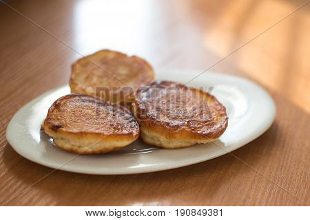 pancakes on a plate on a dark background at home the light from the window