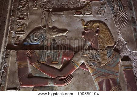 Anubis Depicted - ancient Egyptian god with jackal head. Anubis was the god of mummification. Temple to Osiris at Abydos, Egypt
