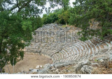 Stone amphitheater in the ancient city of Phaselis. Ancient Phaselis ruins in Turkey Kemer Antalya