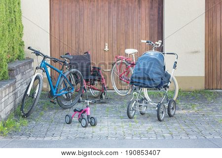Concept shot of a multi-generation-family using bikes and wheelchair