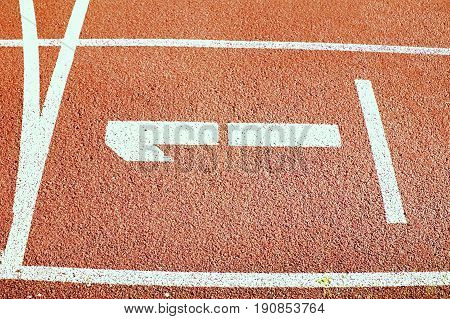 Number One. White Track Number On Red Rubber Racetrack, Texture Of Running Racetracks