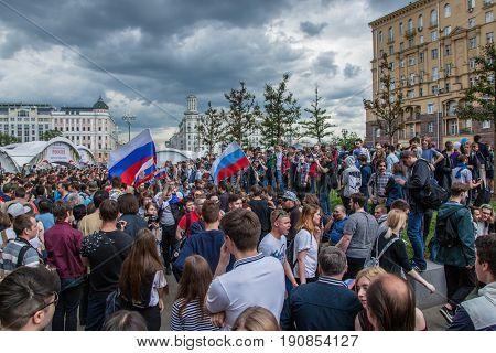 12 June 2017. Russia. Moscow. Tverskaya st. Meeting organized by Alexei Navalny against corruption in  government. Crowd of people standing on street and refuse to go away.