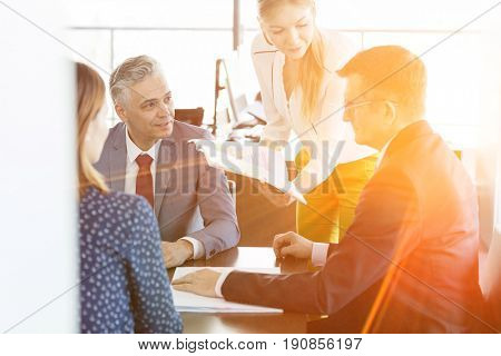 Businessmen and businesswomen in discussion with project in board room