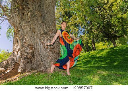 nice stylish little girl enjoying her leisure time in garden, on sunny spring day