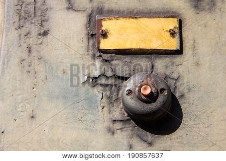 Old vintage door bell button on grunge wall Antique door bell.
