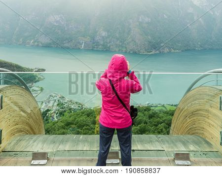 Tourist Photographer With Camera On Stegastein Lookout, Norway