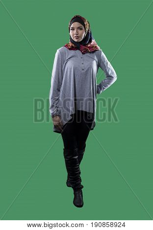 Woman wearing conservative traditional hijab with modern style clothing. The head scarf is associated with islamic religious traditions and middle eastern or east european cultures.