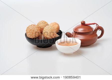 Isolated Macro Shot Tea Pot And Tea Cup