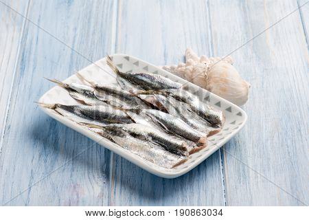 raw fresh anchovies over dish