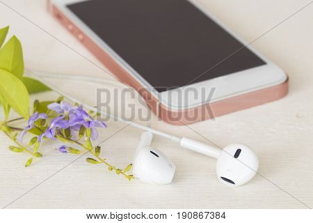 mobile with earphone for communicate on background white