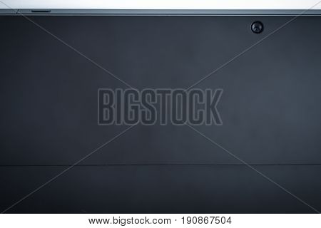 Back of tablet black background with camera modern look