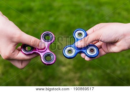 Kid hands with popular toy fidget spinners