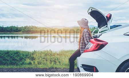 Relaxed Happy Woman Traveler On Summer Roadtrip Vacation On Hatchback Car
