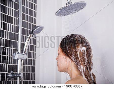 Woman Washing Head And Hair In The Rain Shower By Shampoo