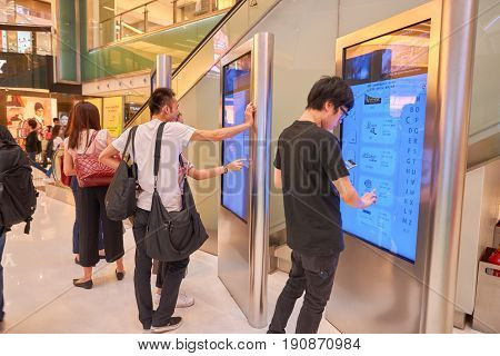 HONG KONG - CIRCA SEPTEMBER, 2016: people use information kiosks at New Town Plaza shopping mall in Hong Kong.