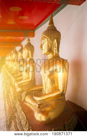 Beautiful Golden Buddha, Many Buddhist Statue In Gold Color Row Sitting Make Concentration Posture T