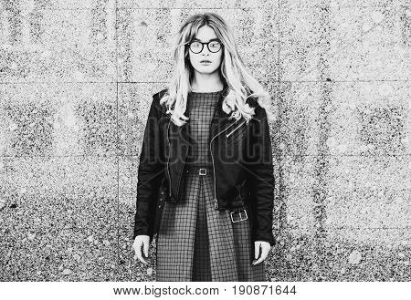 lifestyle, fashion and people concept: blonde girl posing over w