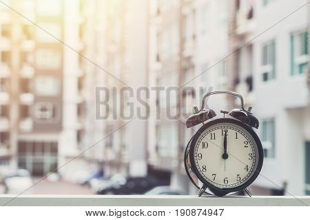 12 O'clock Retro Clock With The Clock Condominium Background.