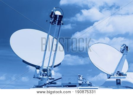 Satellite dish mounted mobile vehicle blue color tone.