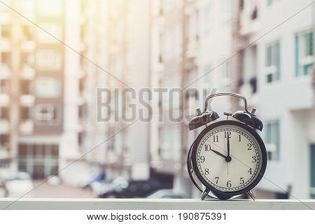 10 o'clock retro clock with The Clock condominium background. poster