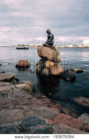 Copenhagen Denmark - August 10 2016. The Little Mermaid. The Little Mermaid is a bronze statue by Edvard Eriksen. The sculpture is displayed on a rock by the waterside in Copenhagen