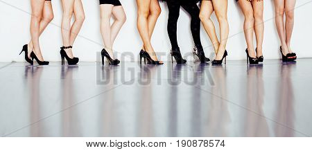 diverse type pair of woman legs in hight heels black shoes isolated on white background and floor, diversity people lifestyle concept close up