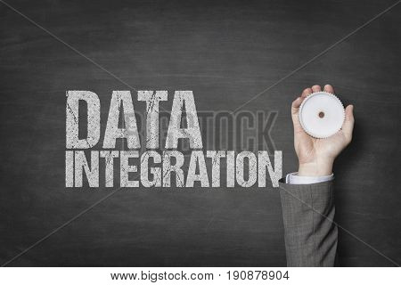 Data integration text with businessman hand holding cogwheel