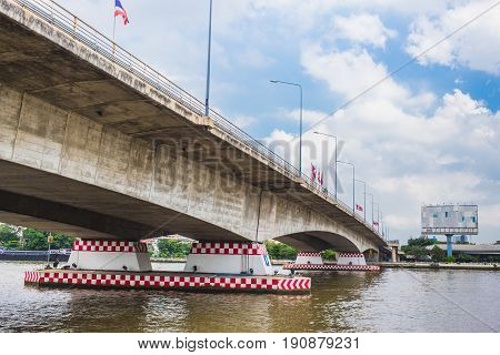 Rama 7 Bridge,concrete Bridge Across Chaopraya River In Bangkok Thailand.