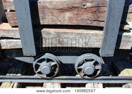 Mining Cart With Wood On Railway In Village Usilne