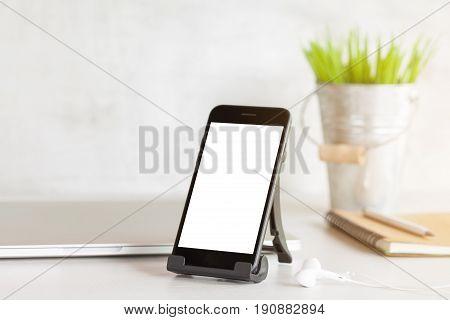 phone showing white blank screen on work desk