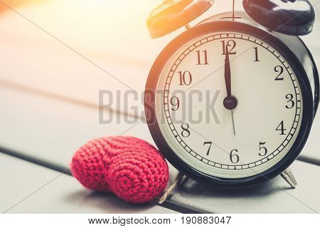 12 O'clock Of Retro Vintage Clock With Red Heart And Sun Light Morning, Loving Time Or Memory Times.
