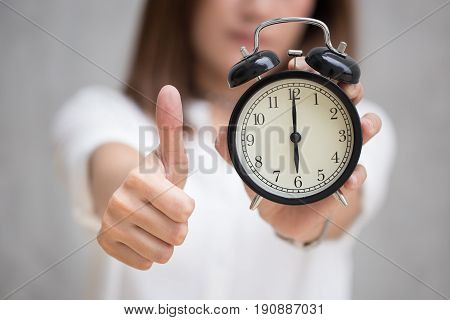 Good Job, Best To Do In Time Or Great Times Concept, Women Show  Thumb Up Hand Hold Retro Clock Show