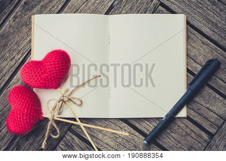 Open Empty Pocket Paper Book Notebook Or Memo On Wood Table With Red Heart Yarn And Pen, Writing Swe